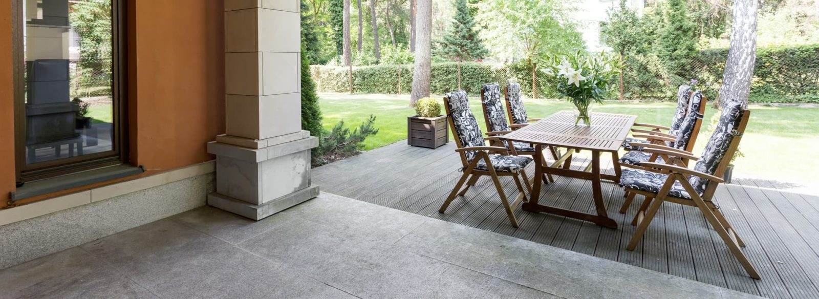 panoramic view of a garden patio with furniture