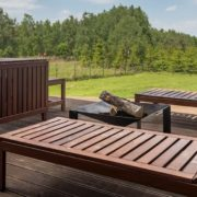 a raised deck area with patio furniture