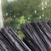 close up of a brush cleaning a window