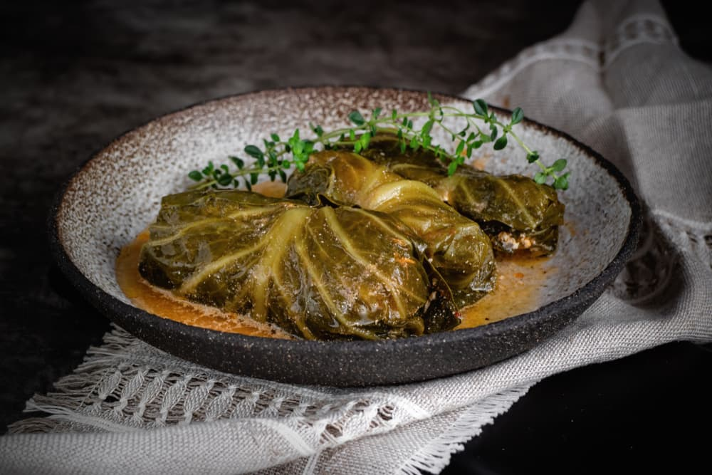 cabbage rolls filled with meat on a ceramic plate