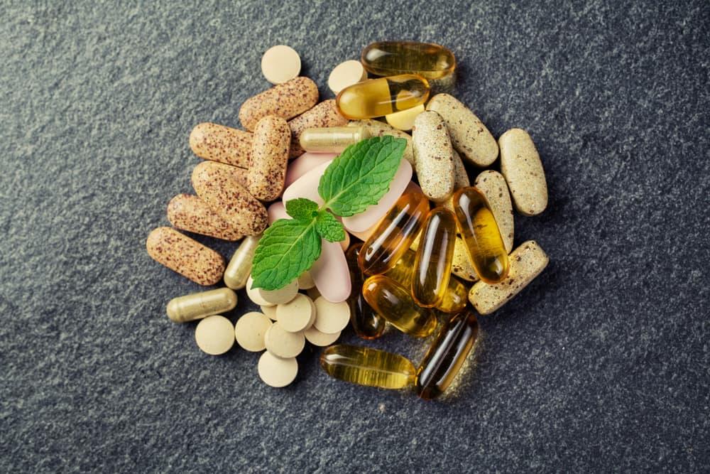 various vitamins on a grey countertop