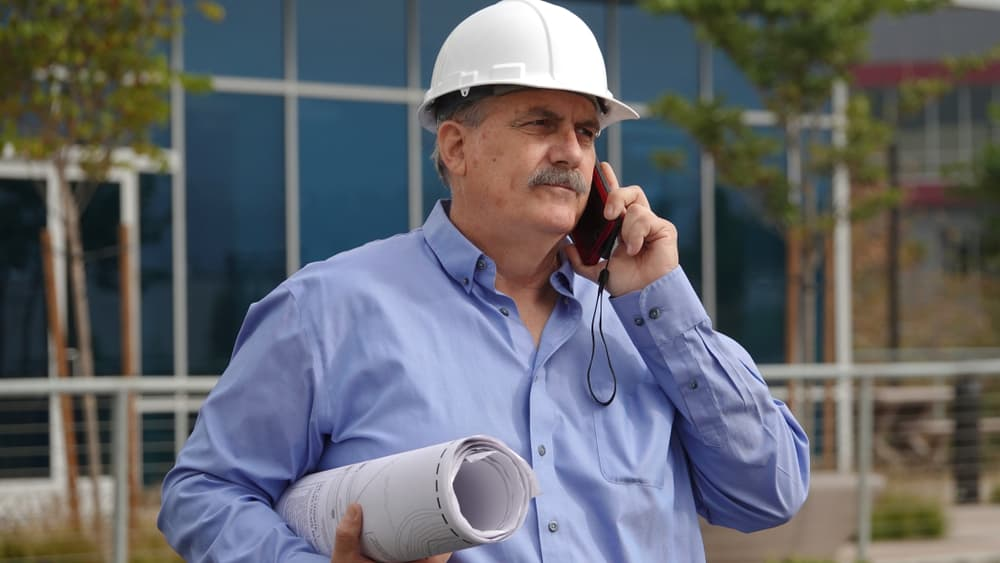 a construction professional on the phone