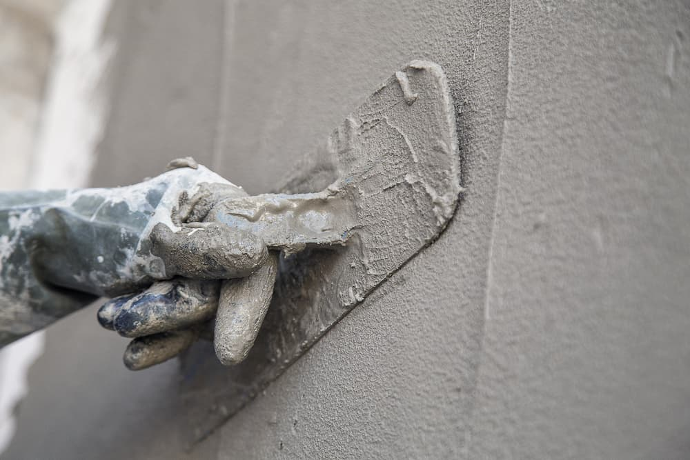 close up of a wall being rendered in grey