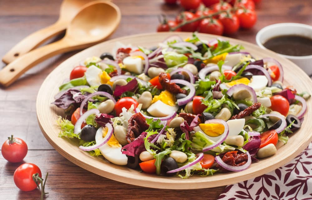 salad with eggs, lettuce, tomatoes and broad beans
