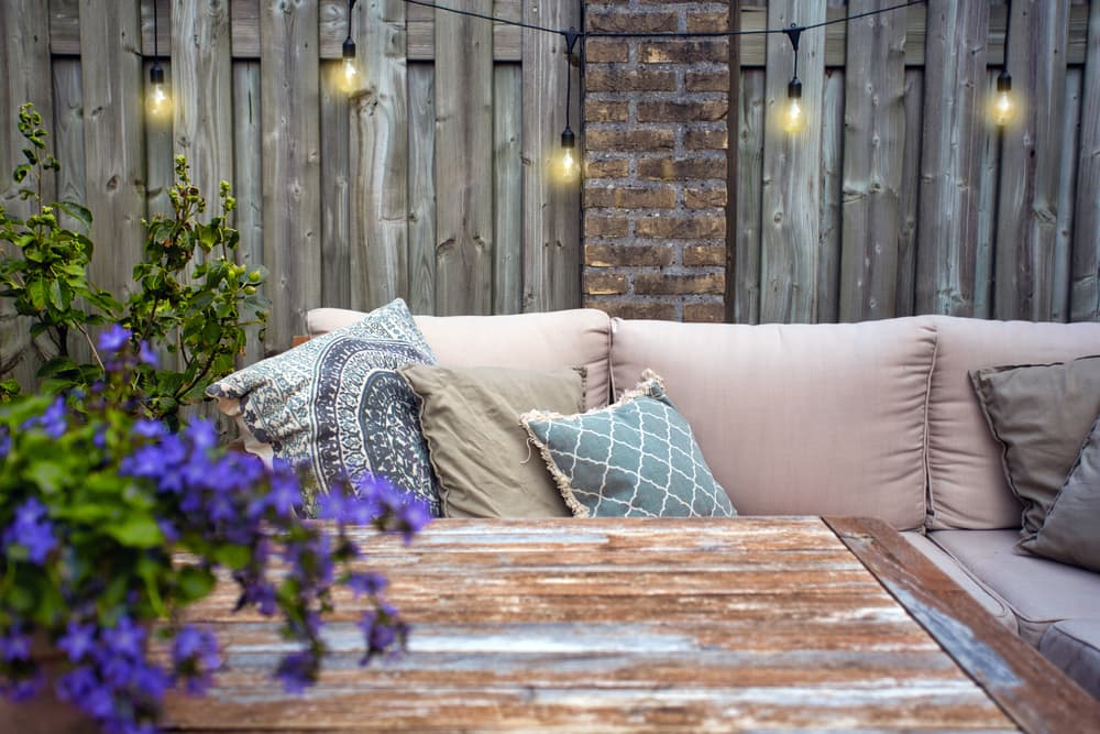 stylish outdoor garden furniture with string lights