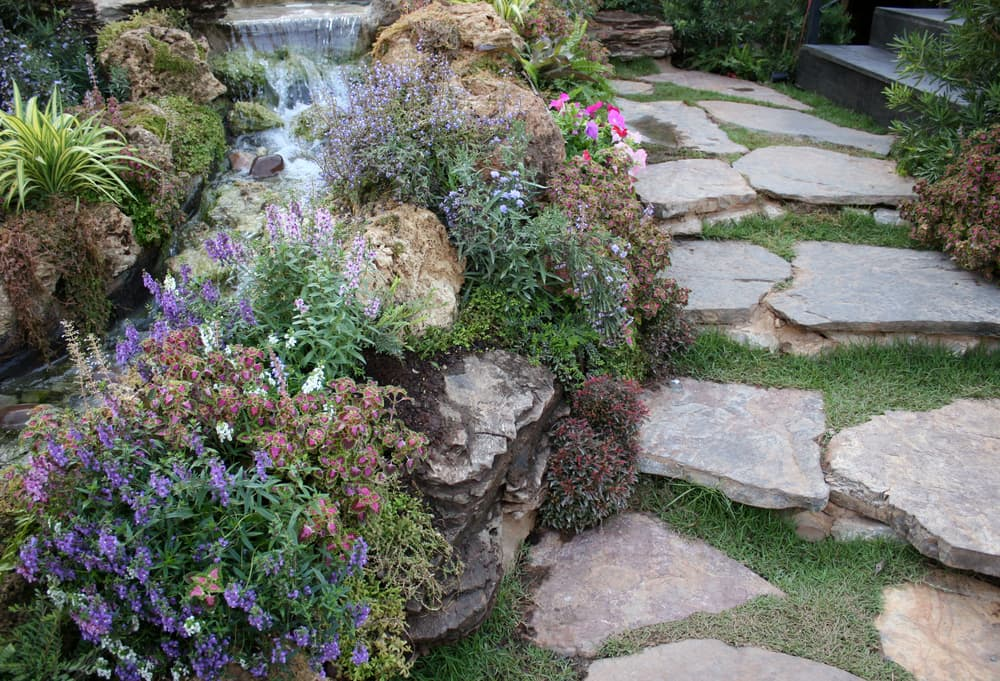 beautiful stone walkway with a water feature to the left