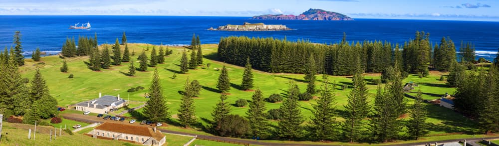 Norfolk Island golf course lined with norfolk island pines