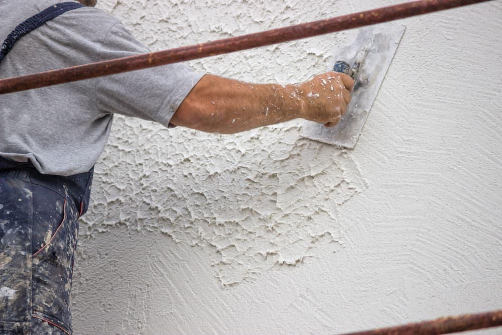 worker applying mottled effect exterior concrete