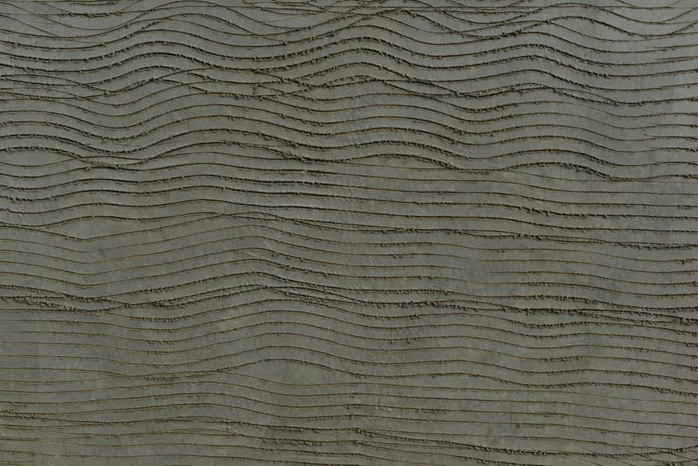 lines in a scratch coat of render