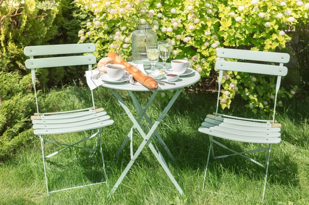 light blue furniture in the garden with a continental breakfast