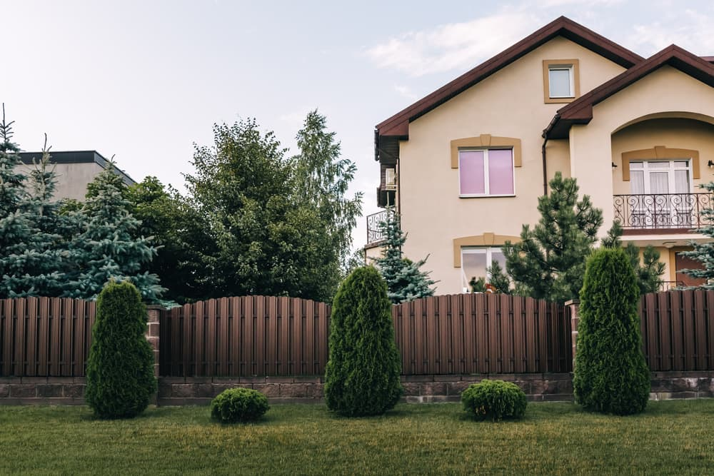 brown vertical fencing outside of a home