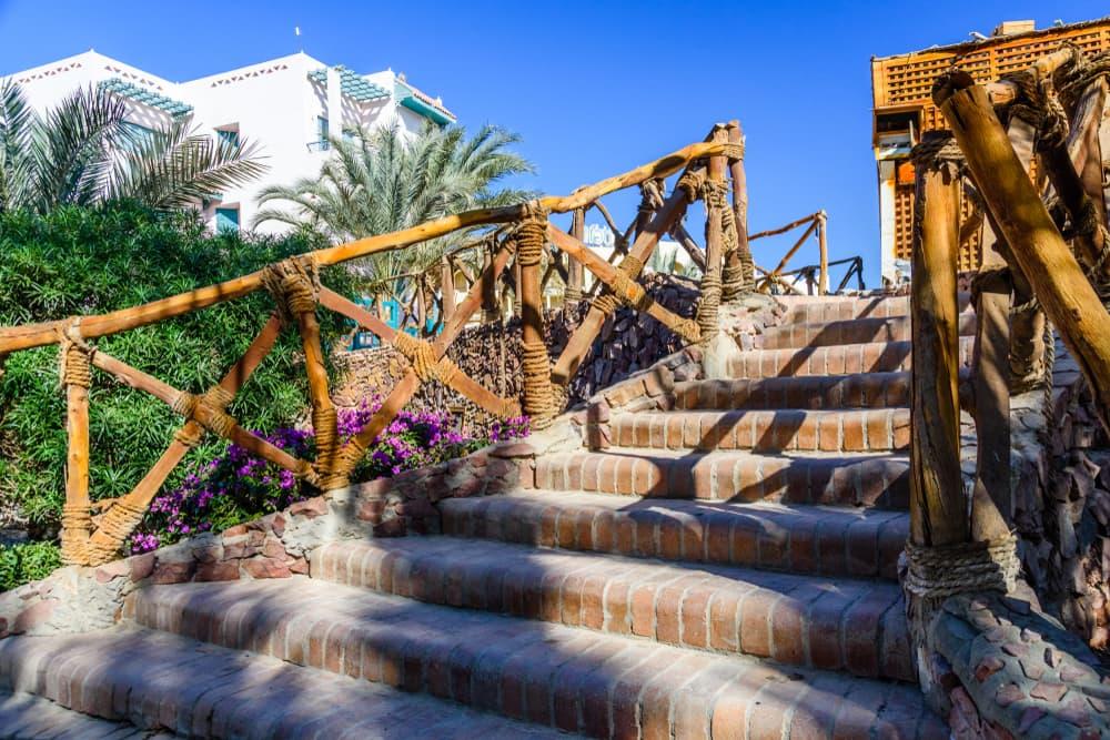 brick steps with log handrails