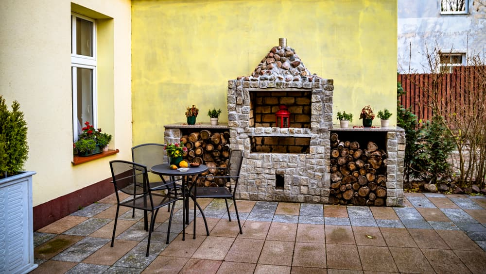 a wall mounted fireplace on a patio