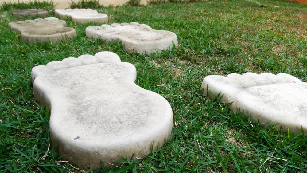 big concrete footprints in grass