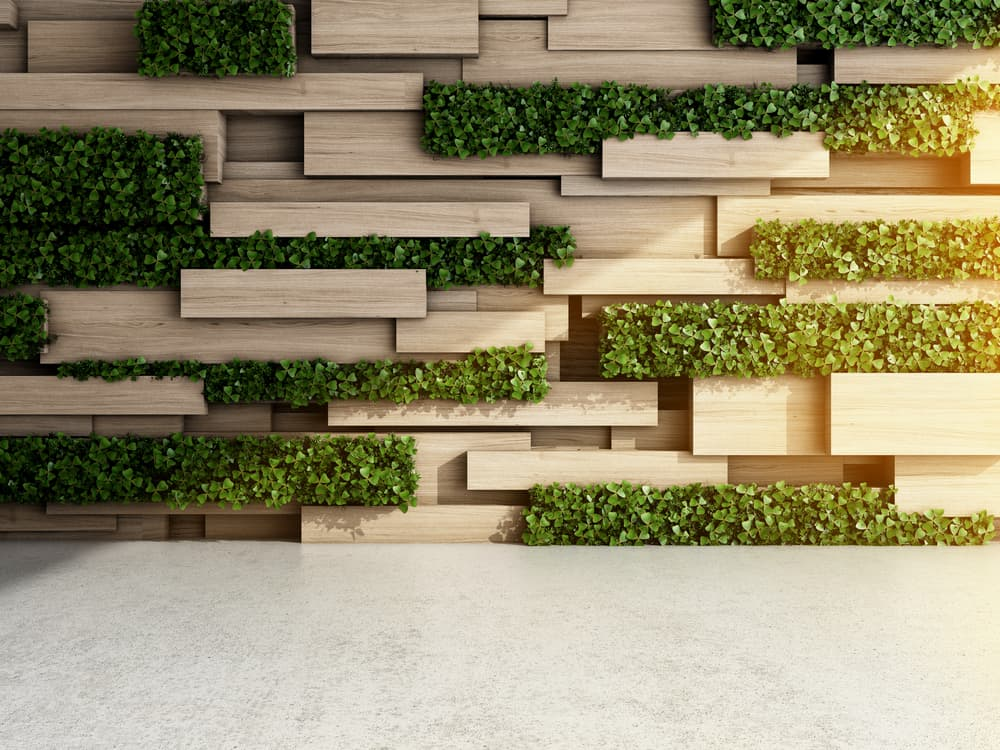 a 3D wall using timber slabs and hedging