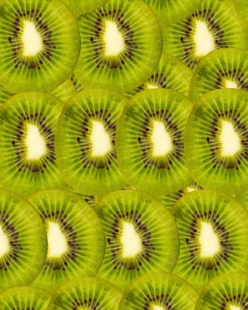 slices of kiwi fruit layered on top of one another