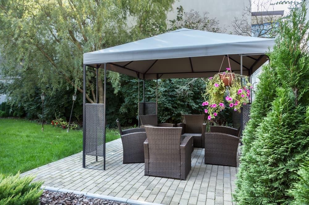 a patio gazebo covering garden furniture