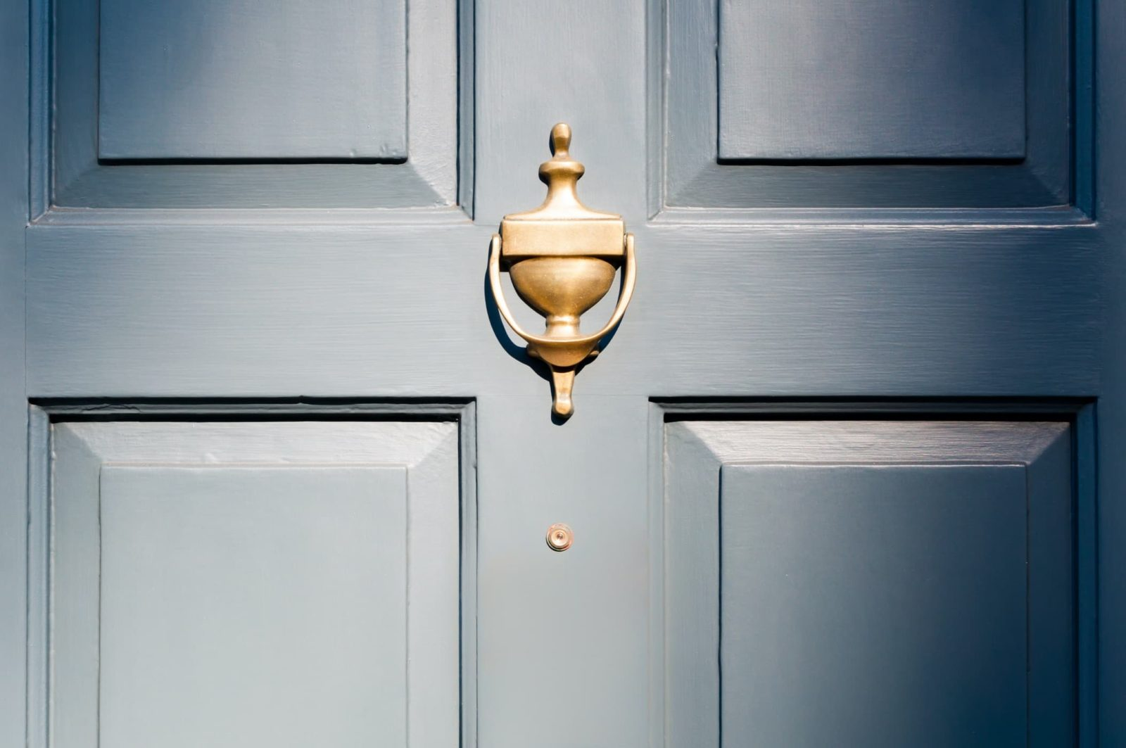 exterior door with traditional knocker painted in royal blue