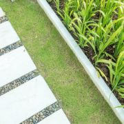 garden walkway with white patio slabs