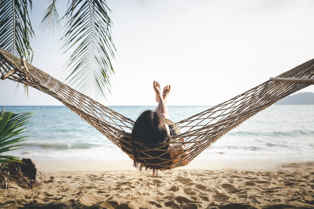woman in a hammock by the sea