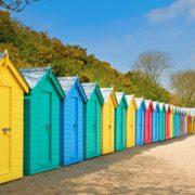 colourful huts on a sunny beach
