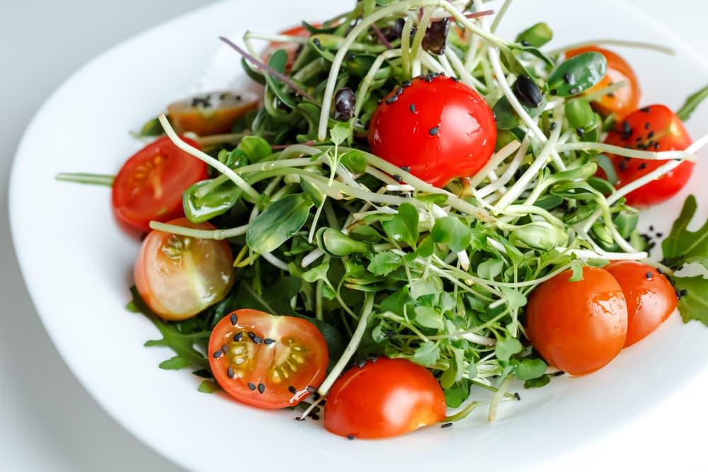 a microgreen and arugula feta salad with tomatoes