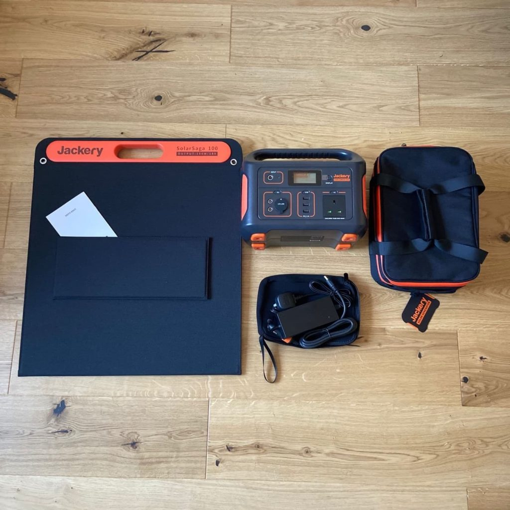 jackery generator and accessories unboxed laid out on floor